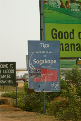 Visitors to Sogakope are welcomed by Tigo, one of Ghana's three major cell phone carriers and the operator of the country's biggest mobile money system.