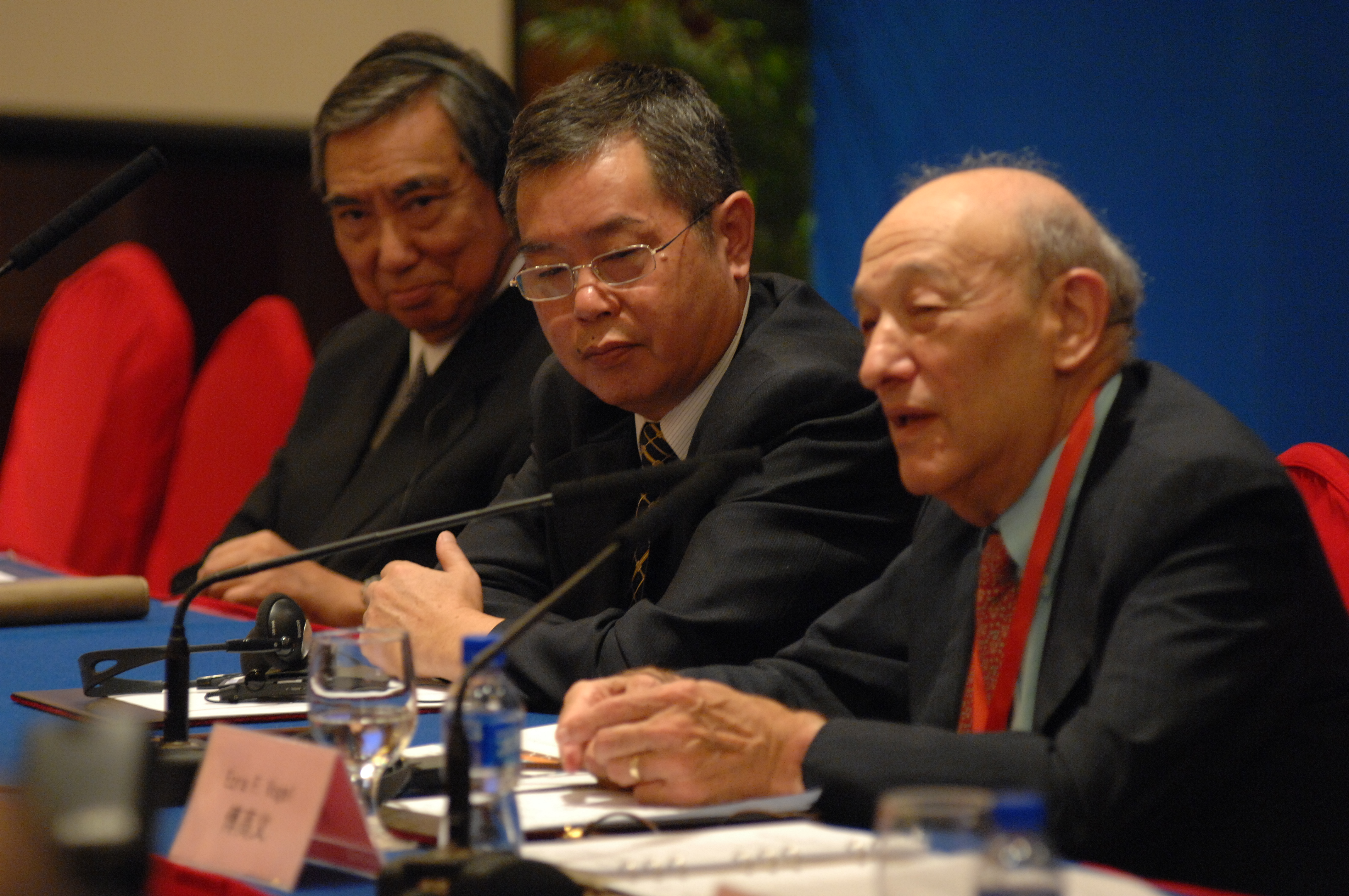 Ezra Vogel, right, speaking at the Beijing symposium on the China-Japan-US relationship with Yohei Kono, left, and Li Yang, center.