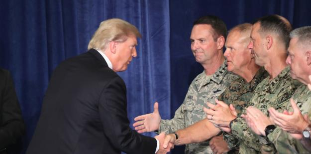 President Trump greets military leaders before his speech on Afghanistan at the Fort Myer military base on August 21, 2017 in Arlington, Virginia. ©Mark Wilson/Getty Images