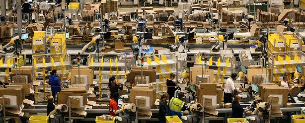 More than a warehouse? Employees process customer orders at Amazon.com's fulfillment center in Britain. (©Chris Ratcliffe/Bloomberg via Getty Images)