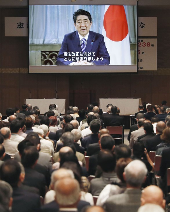 In a video message, Prime Minister Abe announces plans to push through a set of constitutional amendments. © KyodoNews