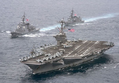 The USS Carl Vinson conducts joint exercises with MSDF vessels in the western Pacific. © KyodoNews