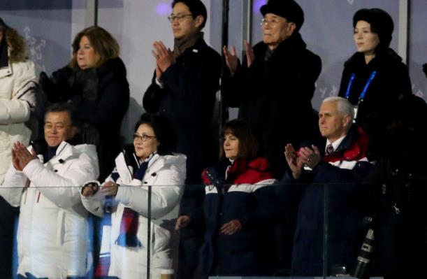 South Korean President Moon Jae-in, left, stands with his wife Kim Jung-sook, and Karen and Mike Pence during the Opening Ceremony of the Pyeongchang Winter Olympic Games. Standing above them, at right, are Kim Yo-jong, sister of North Korean leader Kim Jong-un, and North Korean delegation leader Kim Yong-nam. ©Jean Catuffe/Getty Images