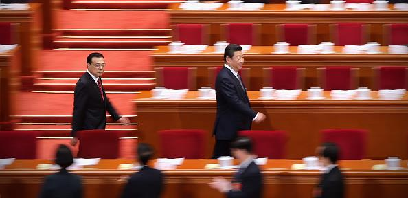 President Xi Jinping (right) and Premier Li Keqiang (left) arrive at the Great Hall of the People. © Feng Li/Getty Images